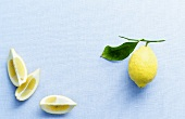 Lemon wedges and lemon with leaf