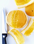 Peeling an orange with a knife