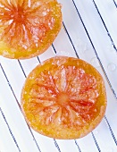 Candied citrus fruit slices on draining rack
