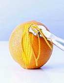 Cutting orange zest with a zester