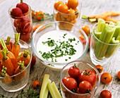Herb yoghurt dip and fresh vegetables