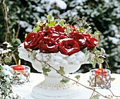 Stucco bowl of red roses and ivy