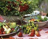 Summery table with strawberries, melon and lady's mantle