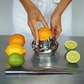 Citrus fruits, half an orange on lemon squeezer