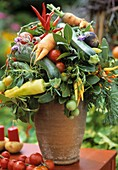 Arrangement of peppers, cucumbers, courgettes, tomatoes & carrots