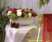 Jardiniere with roses, dahlias and hydrangeas
