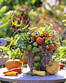 Harvest basket: pumpkins, peppers, tomato, chili, Clematis