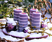 Advent arrangement with four candles and snow