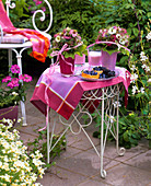 Summery table with flowers in open air