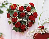 Heart of red roses and Gypsophila