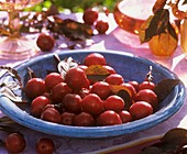 Edible cherry plums in blue bowl