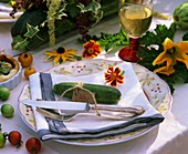 Autumnal place setting with courgette