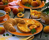 Croissant with butter and apricot jam