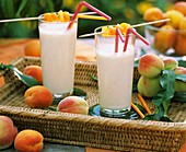 Two milkshakes with apricots and peaches