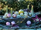 Basket decorated for Advent with apples and candles