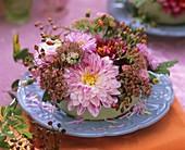 Arrangement of dahlias, Sedum and rose hips