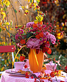 Autumn flower arrangement on table in open air
