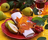 Table with autumnal decorations and pears