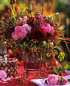 Arrangement of roses, dahlias, stonecrop, ornamental onions, ivy