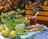 Quinces in green glass bowl and quince jelly