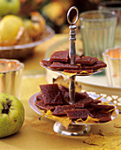 Quince jelly sweets on silver stand, with autumn leaves