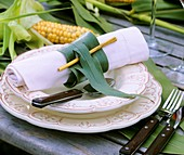 Place-setting with maize leaf as napkin ring
