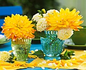 Yellow and white dahlias in glasses