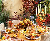 Table decoration of Physalis (Chinese lanterns) & yellow roses