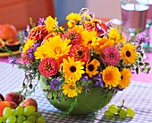 Summer arrangement of marigolds, zinnias and borage