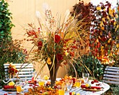 Table with autumn decorations in open air