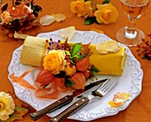 Napkin decoration of yellow roses, rose hips & Chinese lanterns