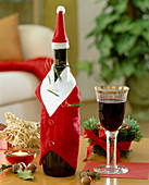 Wine bottle with Father Christmas cover and hat
