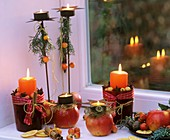 Winterliche Deko mit Äpfeln, Zieräpfeln, Zimtstangen & Kerzen