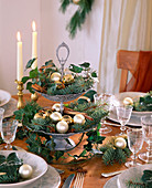 Christmas table decoration with ivy and blue spruce