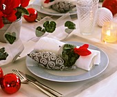 Place setting decorated with red Cyclamen and tree ornament
