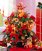 Korean fir decorated with nuts, oranges and red bows
