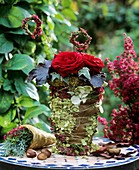 Pot wrapped in hydrangeas, Erica & autumn leaves, moss wreath