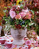 Gerbera, roses & rose hips, carnations, Hedera - ivy, Skimmia