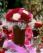 Rosa (roses), Dianthus (carnations), Gypsophila, Chrysanthemum
