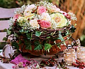Roses and rose hips, ornamental cabbage, Gypsophila, Dianthus