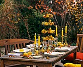 Tiered stand with quinces on laid table with autumnal theme