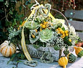 Basket with ornamental cabbage, gourds & peppers and Gypsophila