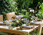 Laid table with woodland decoration