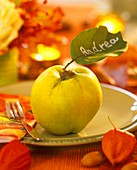 A quince with leaf as place-card