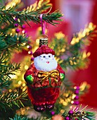 Father Christmas tree ornament on a spruce Christmas tree