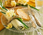 Place setting with narcissi & slice of bread