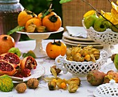Laid table with various tropical fruits and walnuts