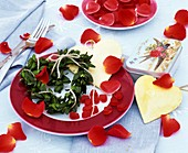 Place-setting decorated with hearts and rose petals