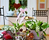 Lilies-of-the-valley & polka dot plant, biscuits on stand