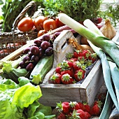 Summer fruit and vegetables in crate and basket